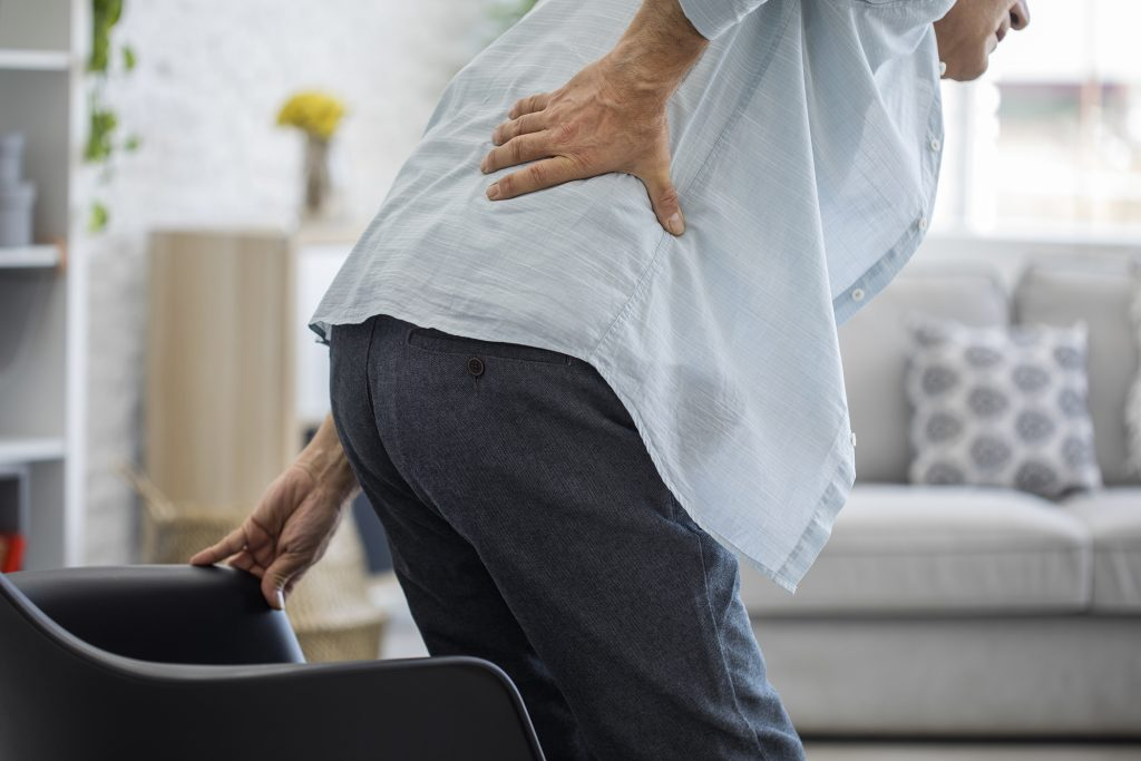 woman leaning over with back pain