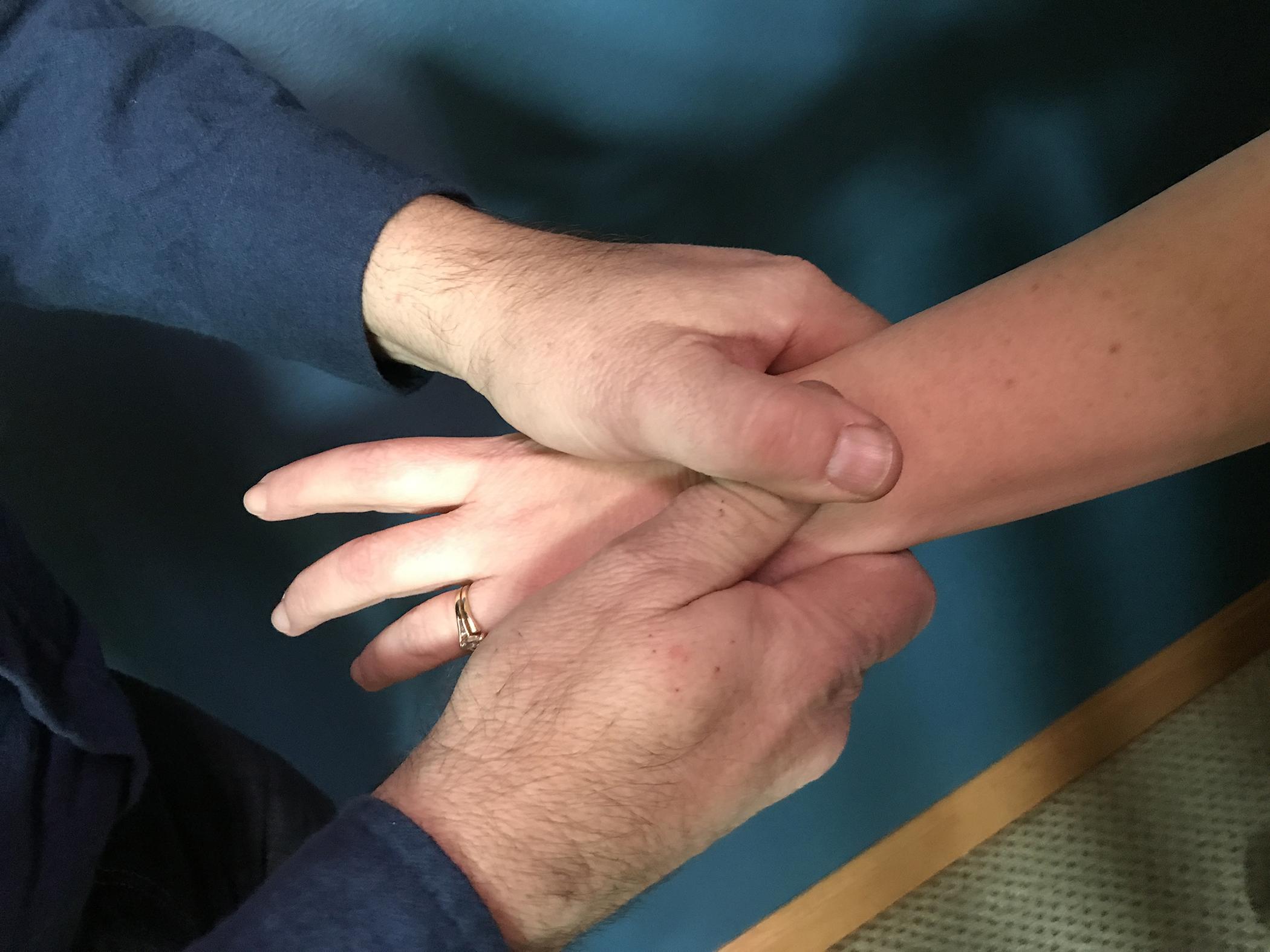 chiropractor adjusts wrist
